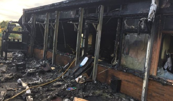 Two teens arrested over school fire