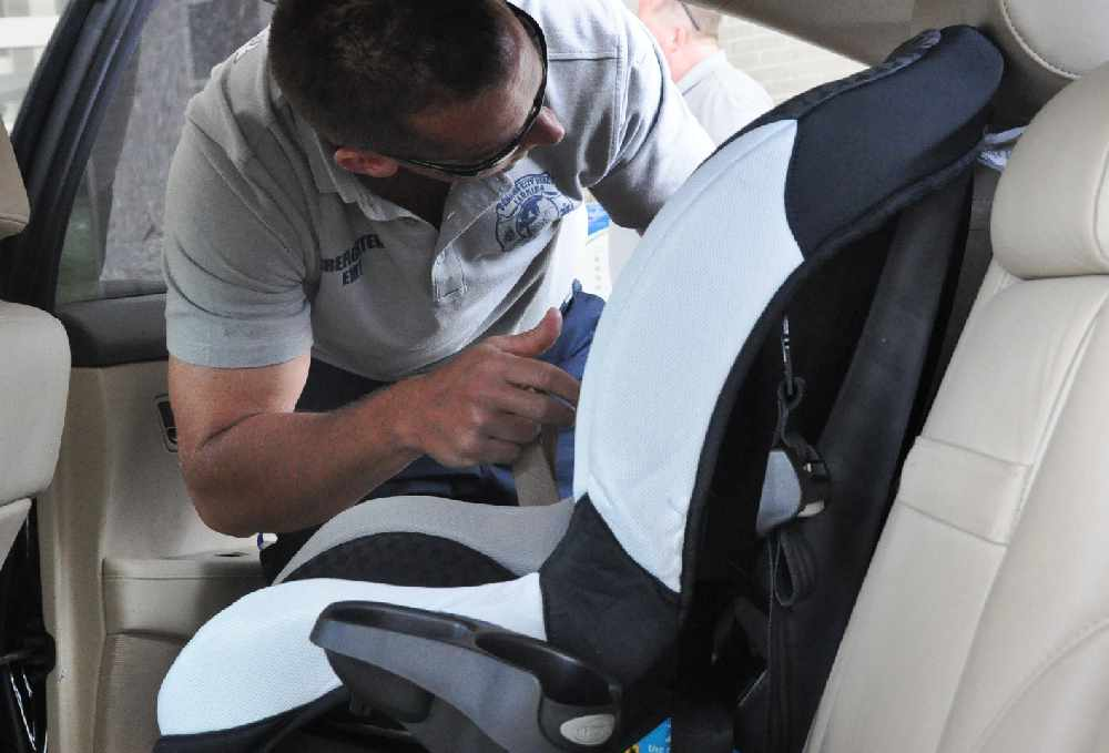 Police offer child seat fitting event