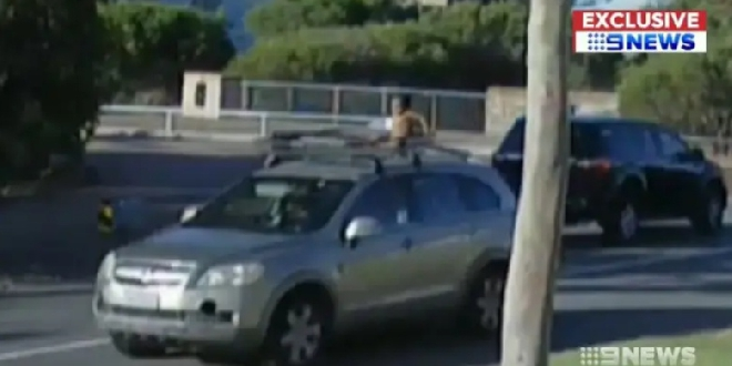 Shocking moment mum drives off with toddler on the roof