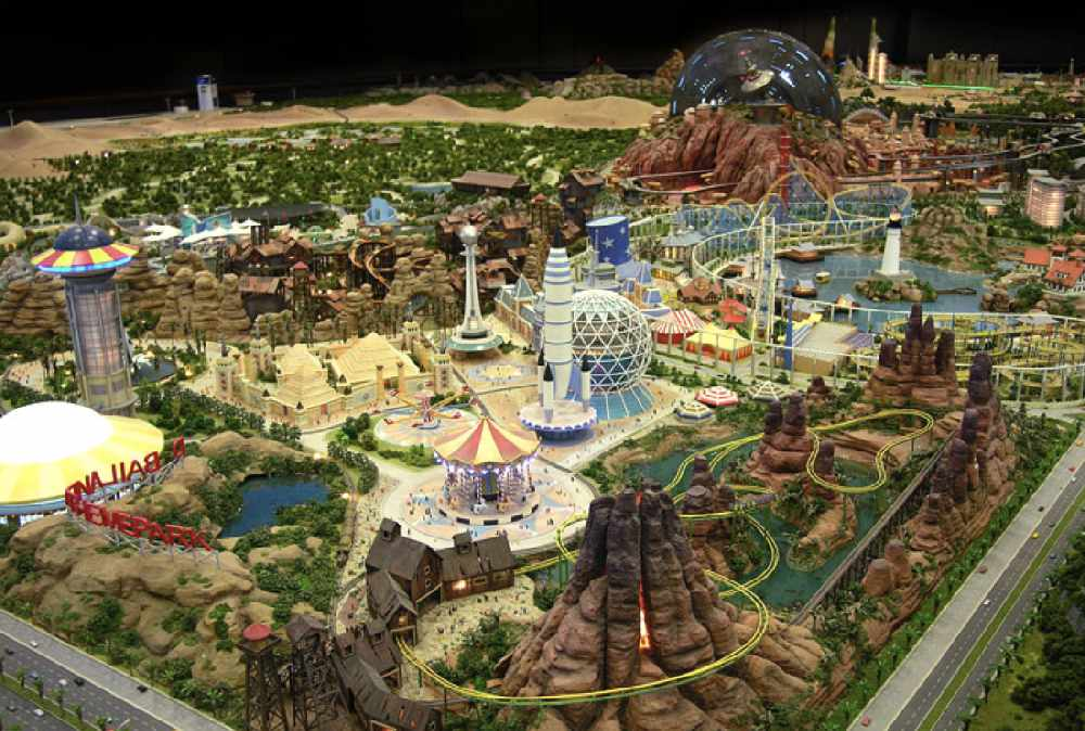 A rendered photo of Dubailand including the rides and surrounding area