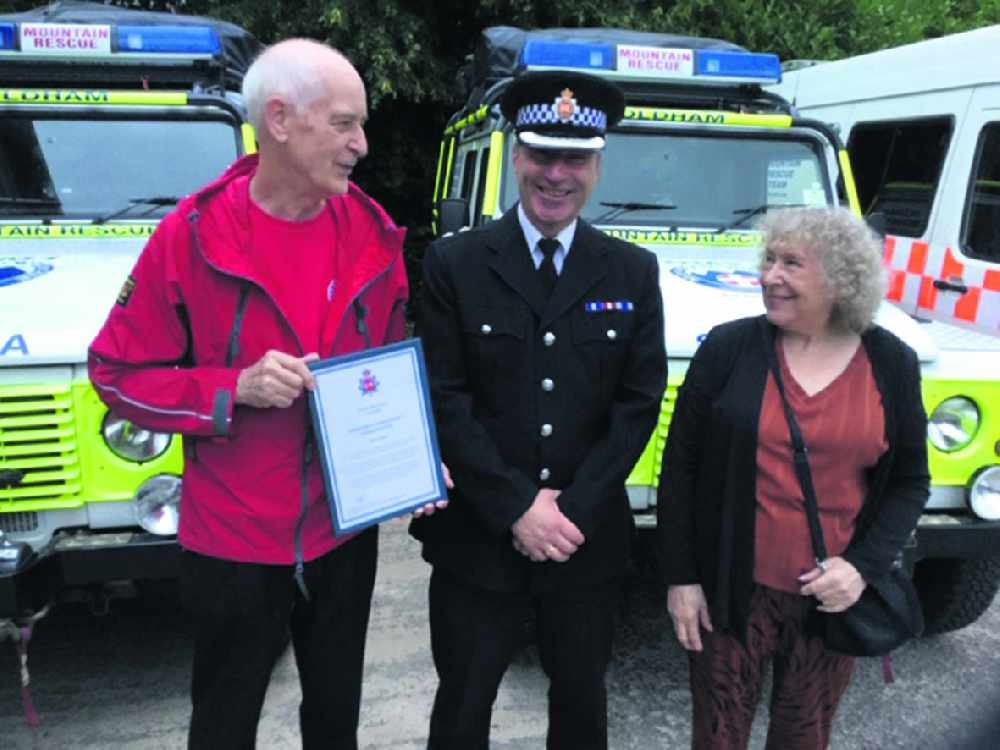 Peter honoured for 54 years service to Oldham Mountain Rescue Team