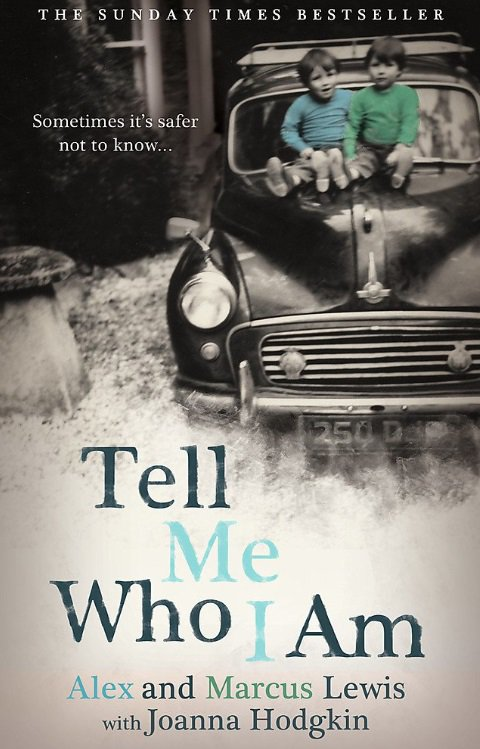 The cover of the book Tel Me Who I am, featuring two young boys, smiling as they sit on the bonnet of a car