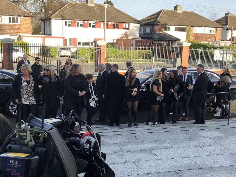 Mourners arrive in Templeogue for the funeral of RTÉ broadcaster Larry Gogan.